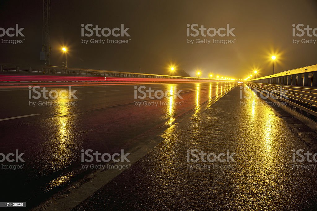 Reflector lights and  Road surface at rainy night stock photo