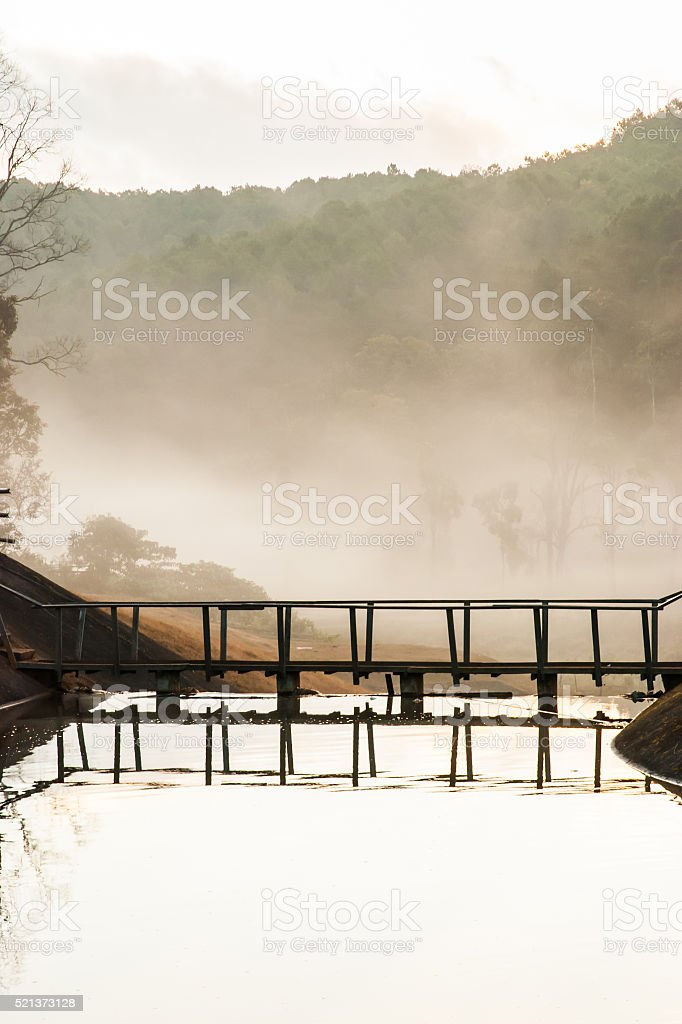 refletion of wooden bridge, Scenic point at reservoir stock photo