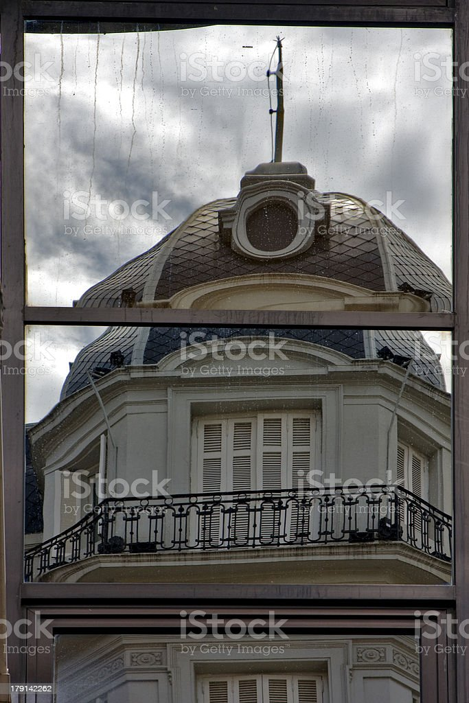 reflex of a palace in window royalty-free stock photo