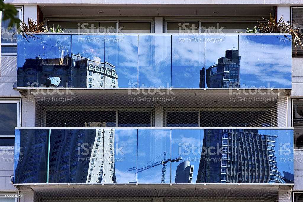 reflex of some palace in a window and   plants royalty-free stock photo