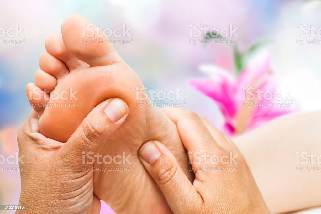 Reflexologist doing massage stock photo