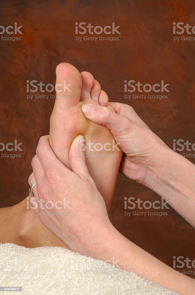 Reflexologist Therapeutic Foot Massage royalty-free stock photo