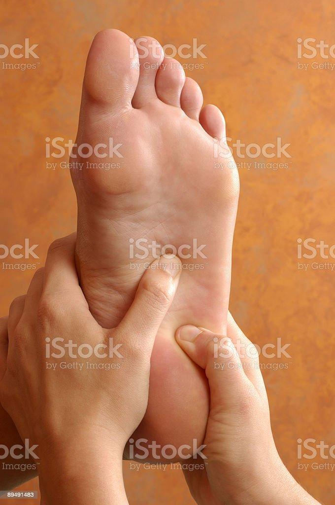 Reflexology Foot Massage at Wellness Center royalty-free stock photo