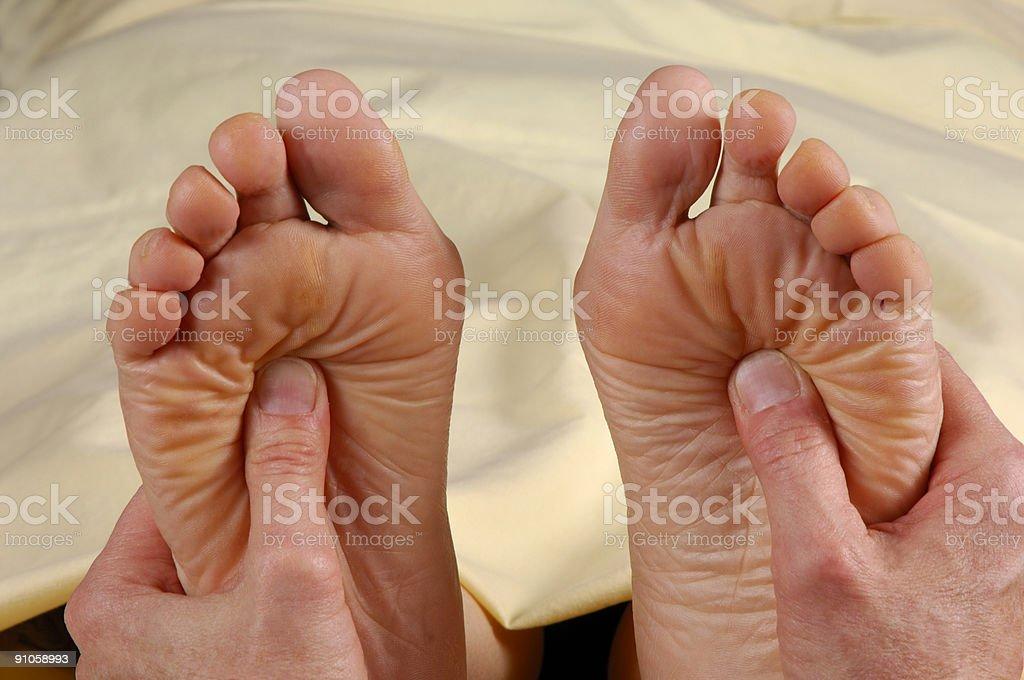 Reflexology Foot Massage Both Feet royalty-free stock photo