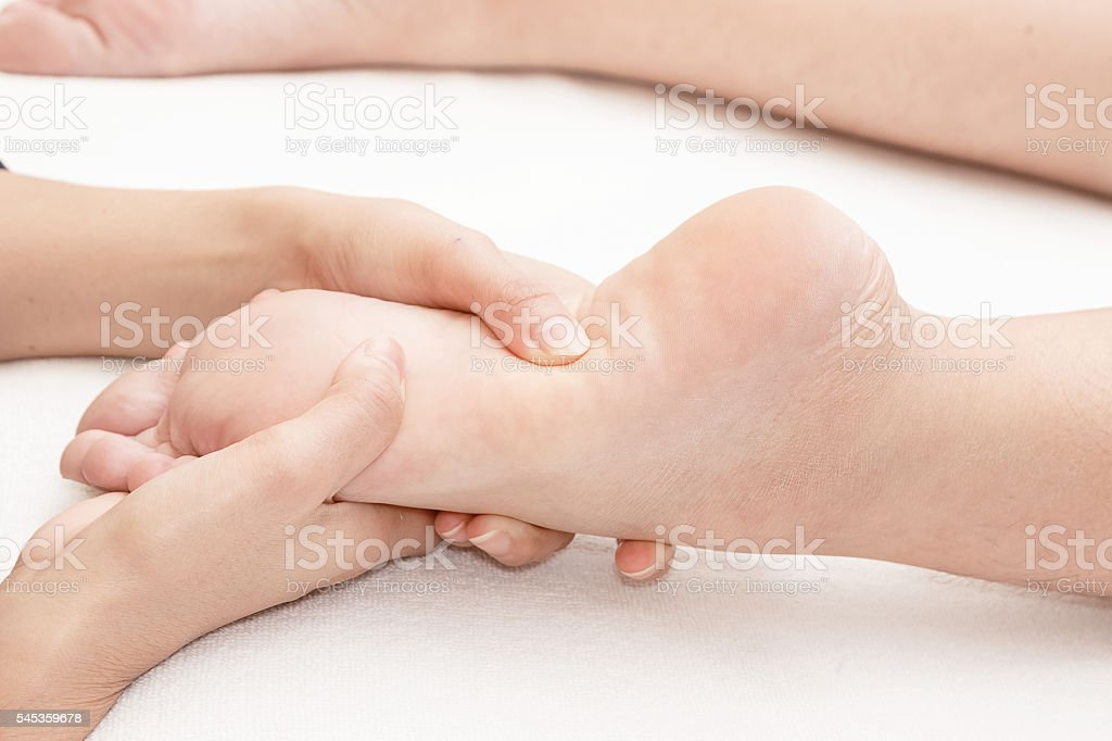 Reflexology foot massage in the day spa stock photo