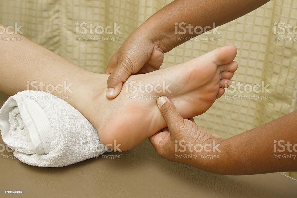 reflexology foot  massage, royalty-free stock photo