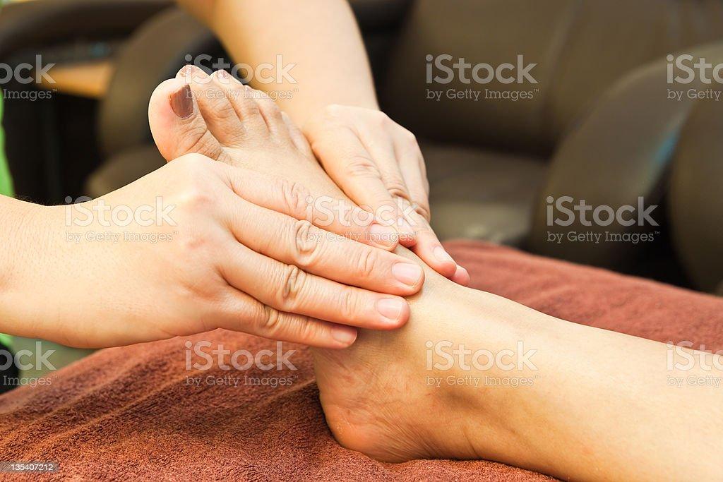 reflexology foot massage, spa treatment,Thailand royalty-free stock photo