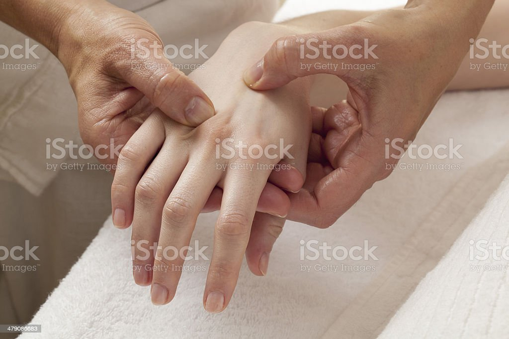 reflexology on hands for relaxation royalty-free stock photo