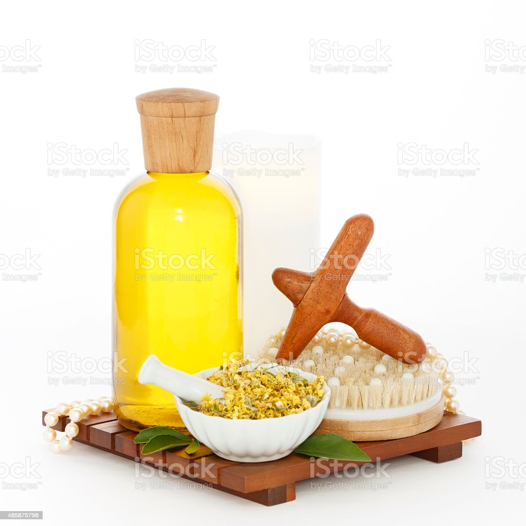 Reflexology Spa Set with Massage Oil Wood Cross Foot Massager royalty-free stock photo