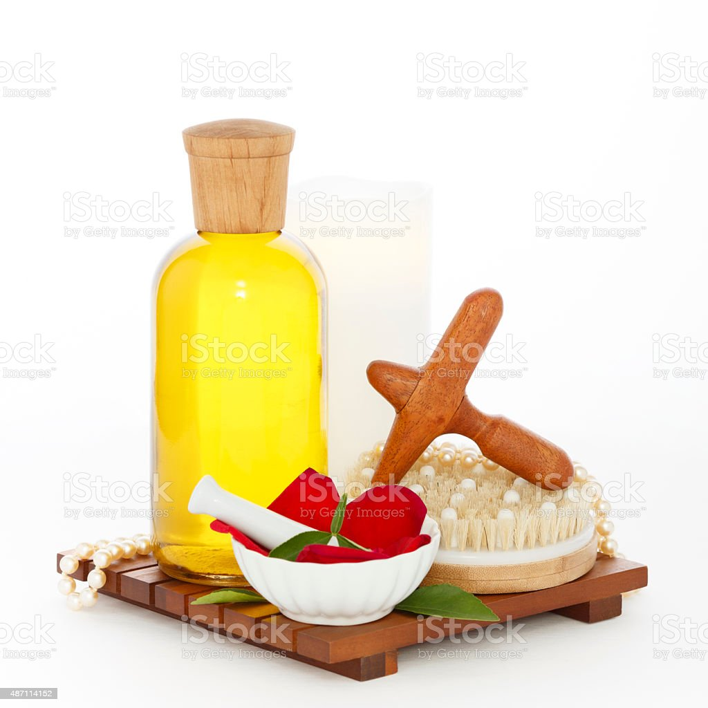 Reflexology Spa Set with Massage Oil Wood Cross Foot Massager royalty-free stock photo