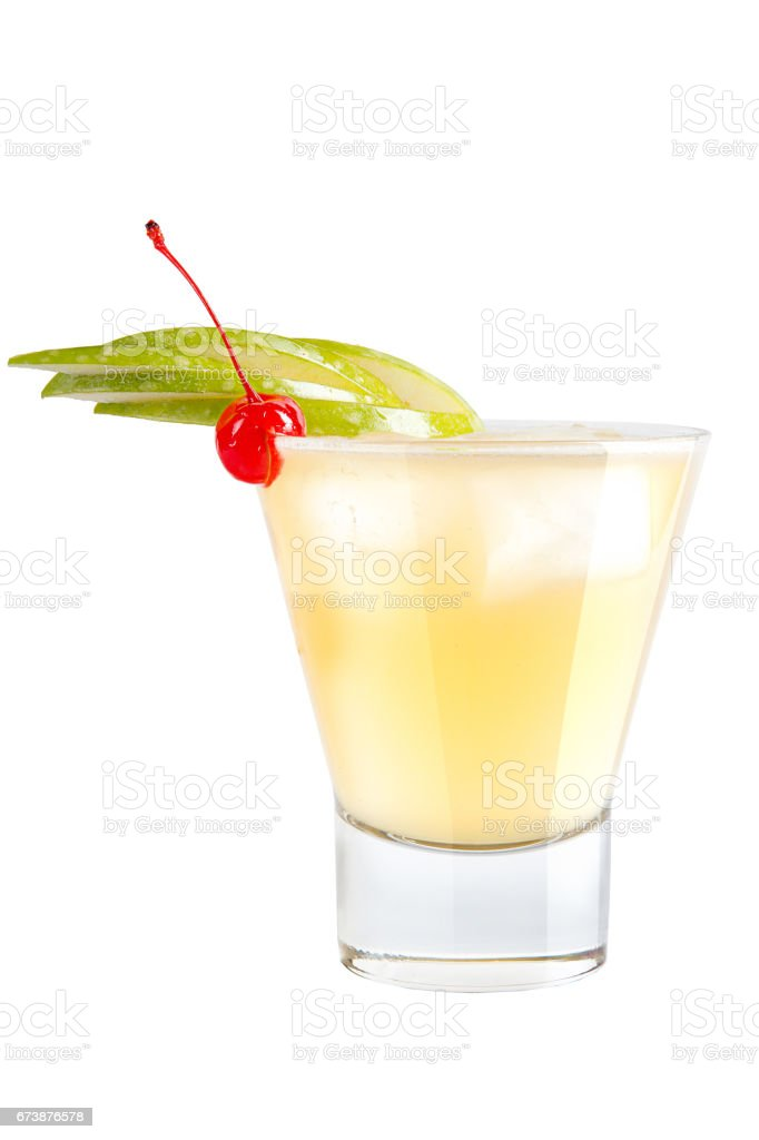 Refreshing cocktail with apple slices and maraschino cherry for decoration stock photo