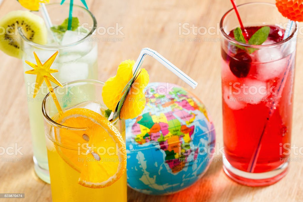 Refreshing cocktails and Globe, concept stock photo