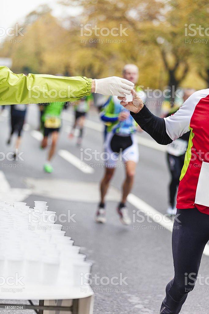 refreshing drink on running marathon royalty-free stock photo