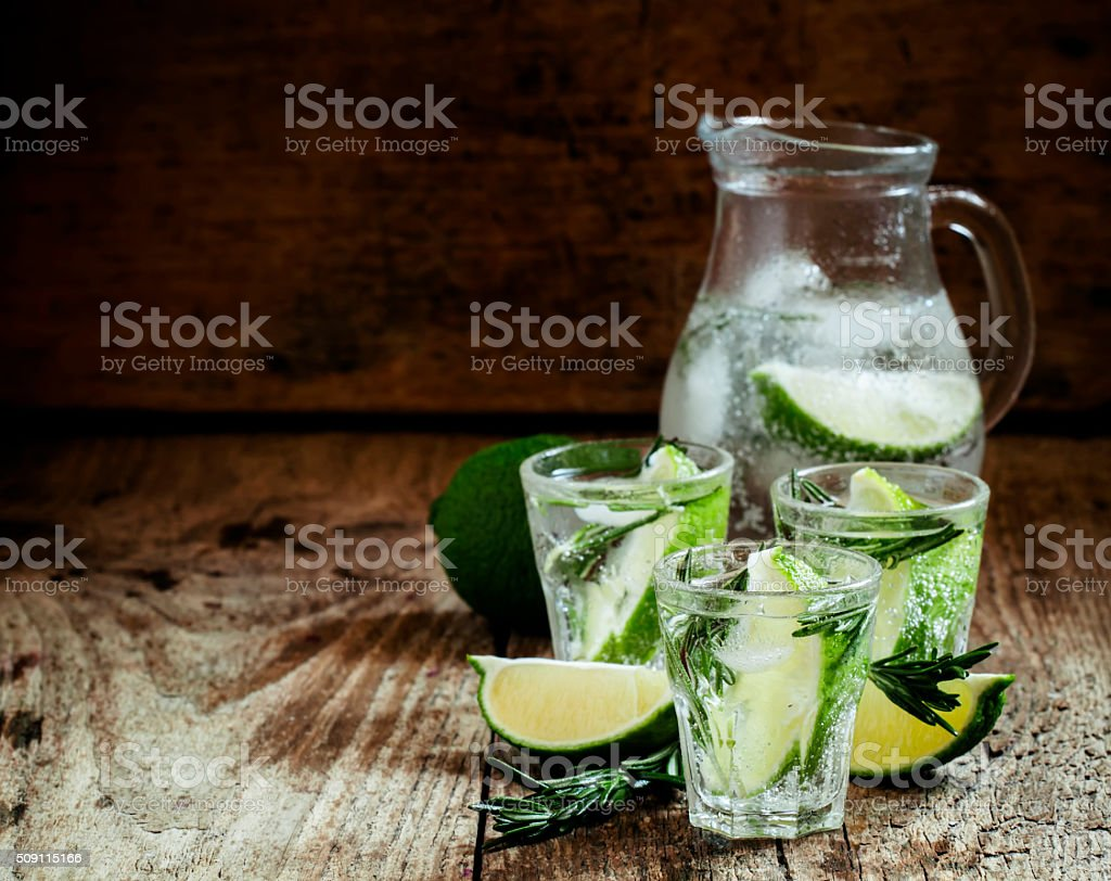 Refreshing drink with rosemary, lime and honey stock photo
