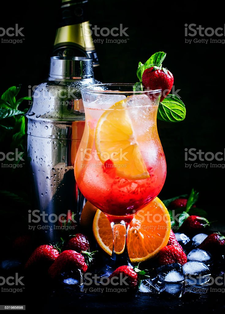 Refreshing drink with sparkling white wine, strawberries stock photo