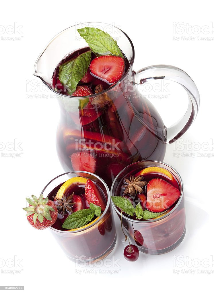 Refreshing fruit sangria in jug and two glasses royalty-free stock photo