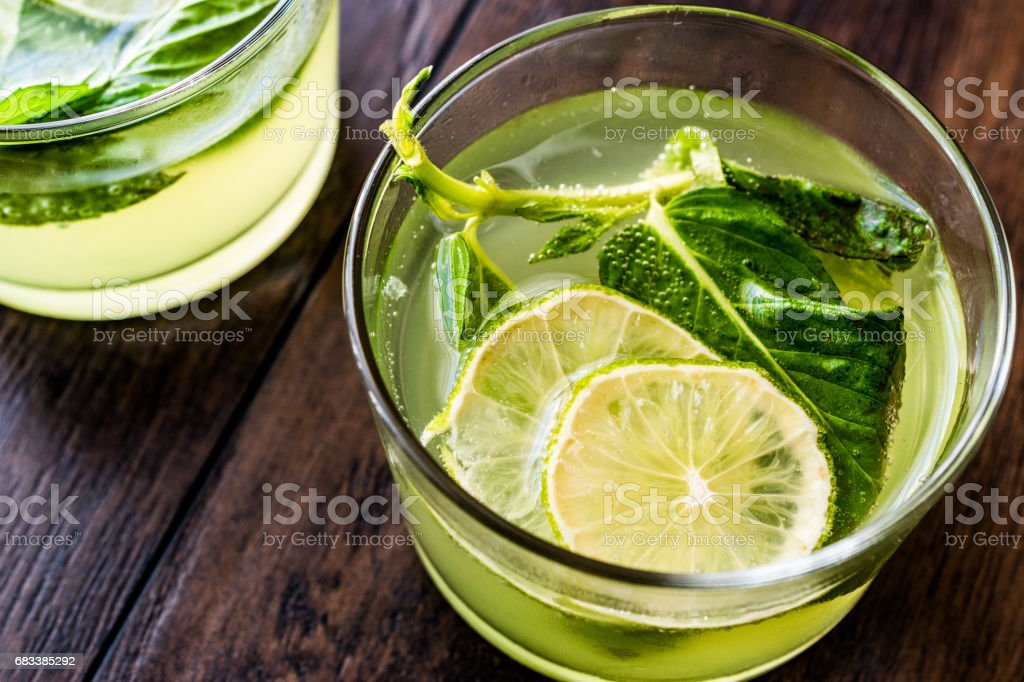 Refreshing green bitter lemon cocktail with mint leaves and lime. stock photo