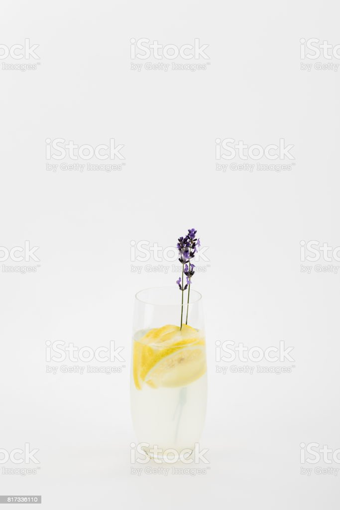 refreshing homemade lavender beverage with lemon pieces isolated on white stock photo