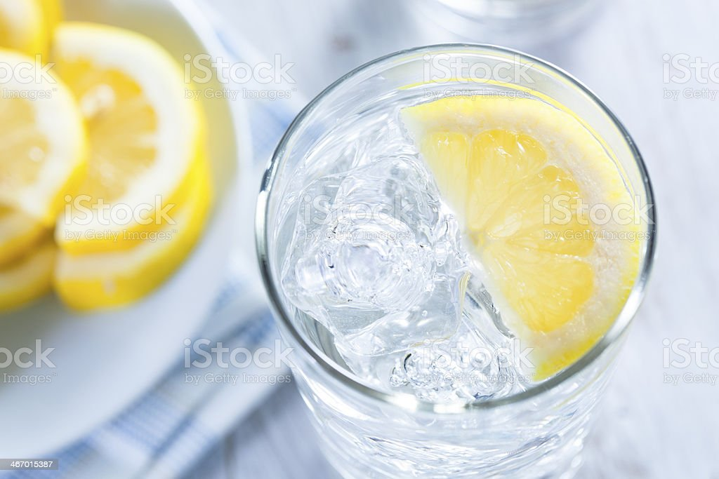 Refreshing Ice Cold Water with Lemon stock photo