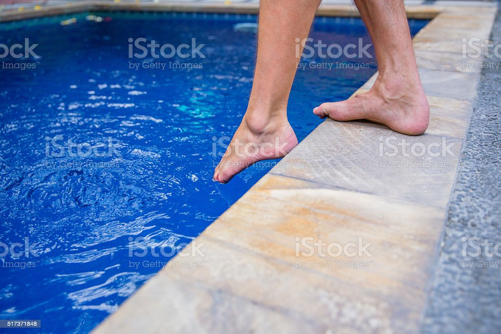 Refreshing in the swimming pool stock photo
