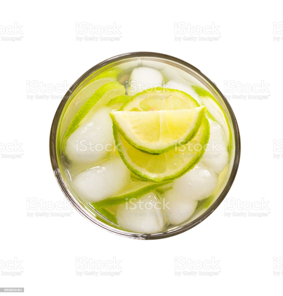 refreshing lemonade with green lemon and ice isolated on white background close-up top view stock photo