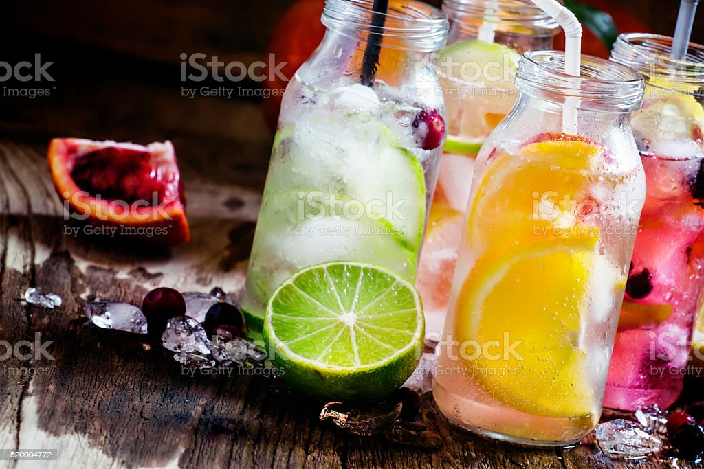 Refreshing lemonades with citrus fruits and ice stock photo