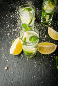 Refreshing lime mojito or tequila with ingredients for it