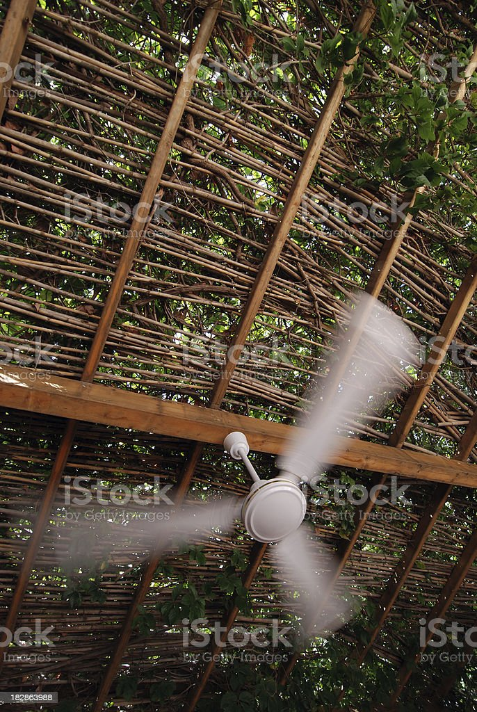 Refreshing patio fan, motion blur royalty-free stock photo