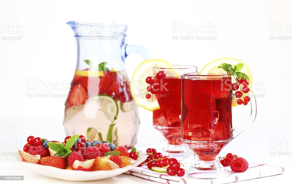 Refreshing summer ice tea with fresh fruits royalty-free stock photo