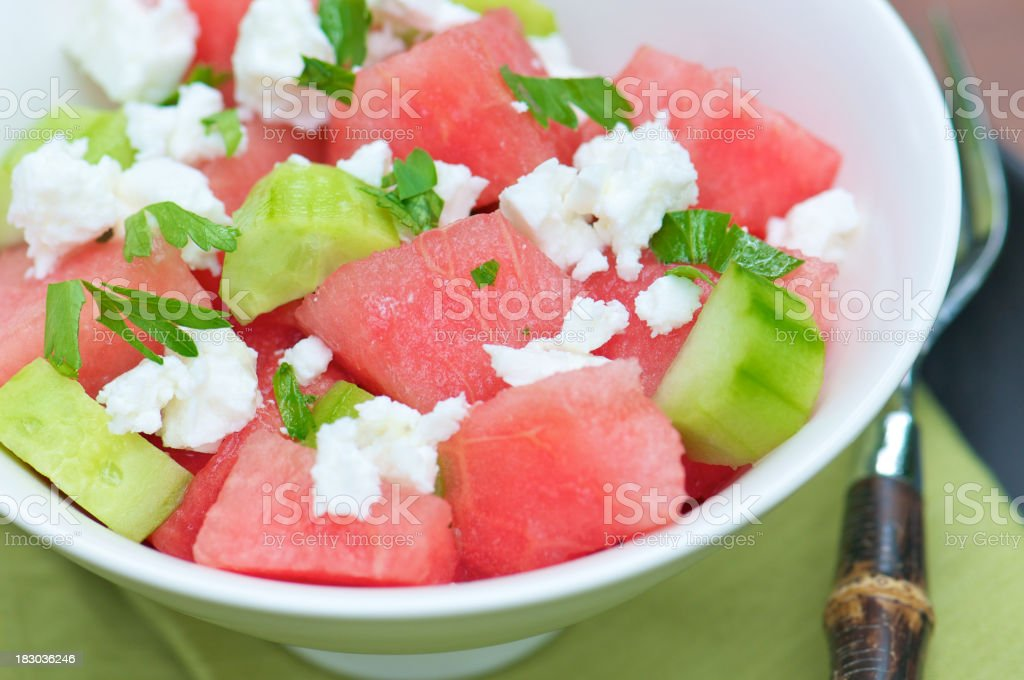 Refreshing Summer Salad with Watermelon and Cucumbers royalty-free stock photo