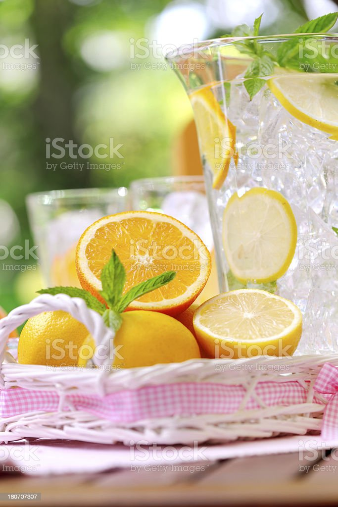 Refreshing water with ice and citrus fruit slices stock photo