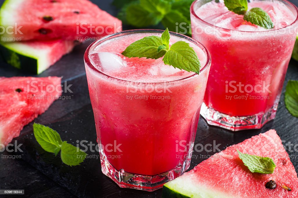 refreshing watermelon cocktail with ice and mint stock photo