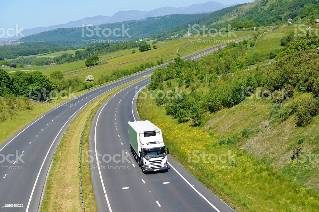 Refrigerated Rigid Goods Vehicle on Open Road stock photo
