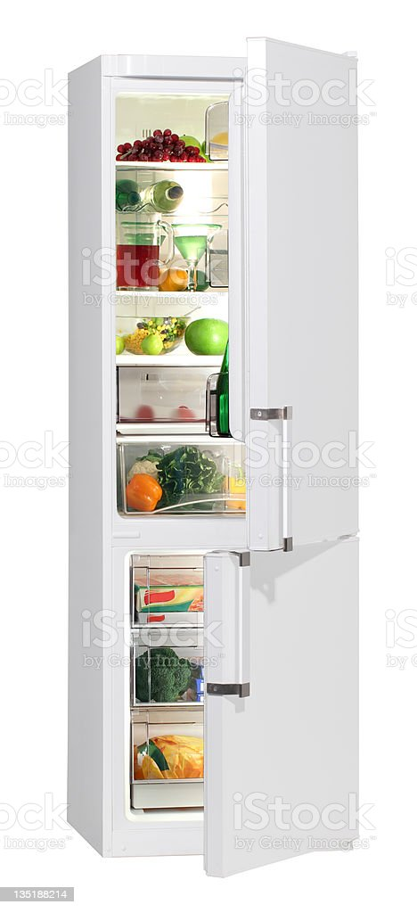 A refrigerator and freezer full of fresh foods stock photo