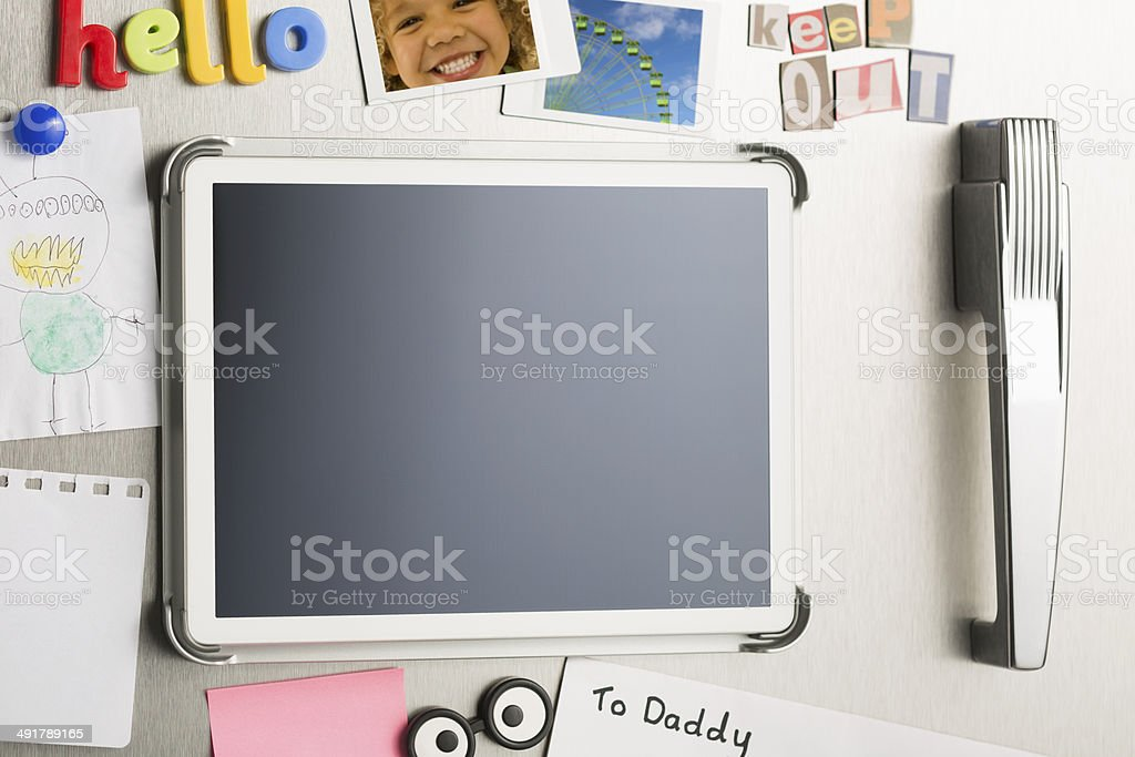Refrigerator door with blank digital touch screen tablet stock photo