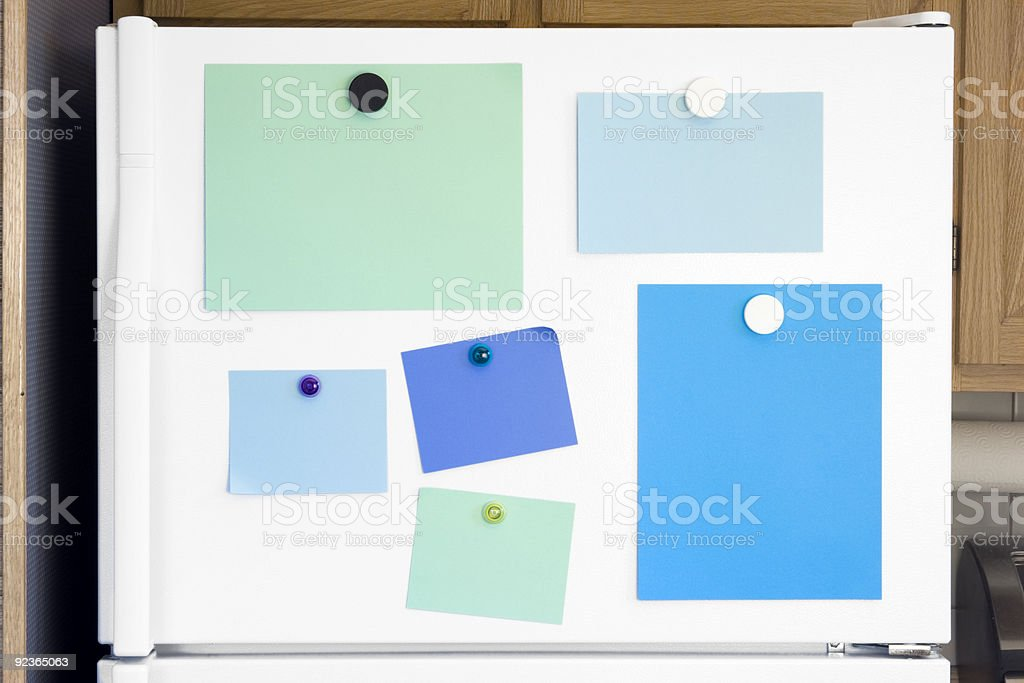 Refrigerator door with multicolored empty sticky notes stock photo