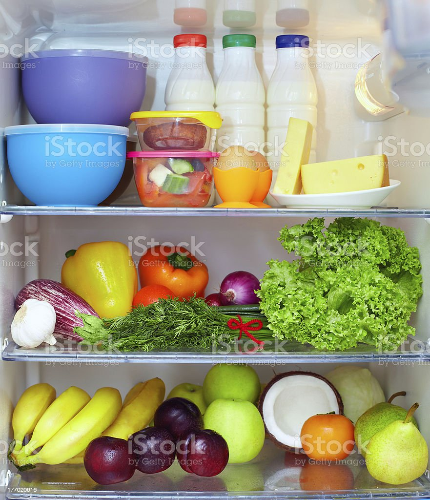 refrigerator full of healthy food. fruits, vegetables and dairy products royalty-free stock photo