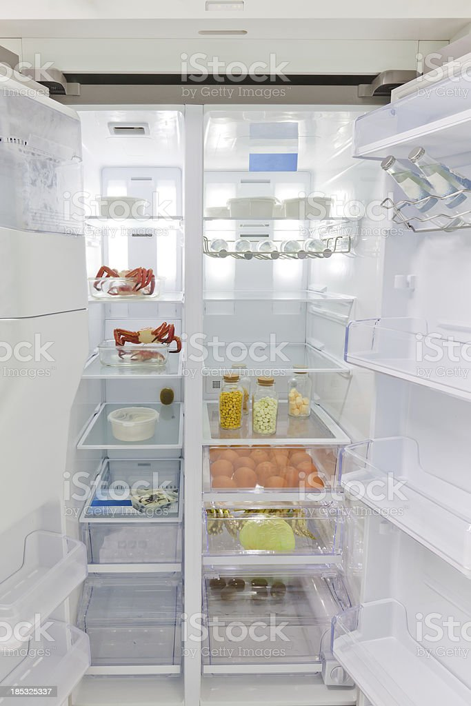 refrigerator full with some kinds of food stock photo