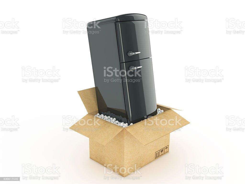 Refrigerator in cardboard box stock photo