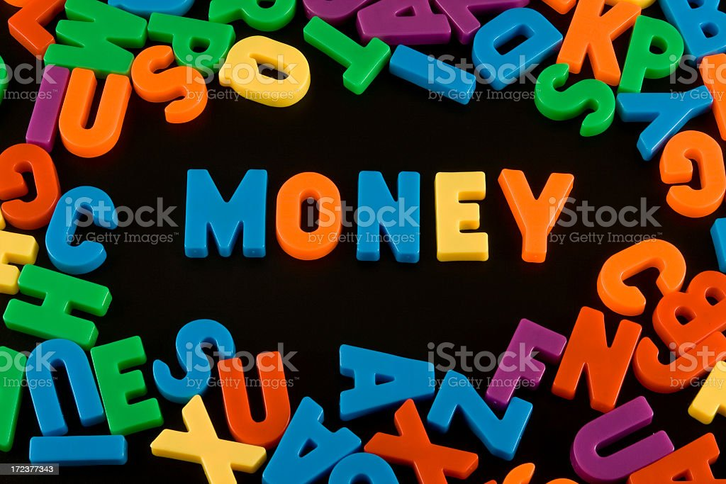 Refrigerator magnets spelling money stock photo