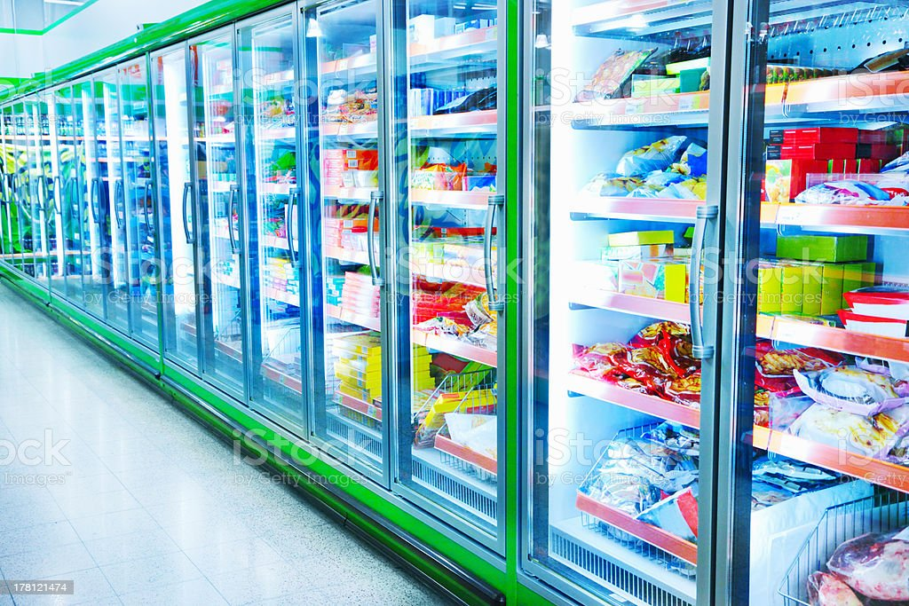 Refrigerators with products in supermarket stock photo