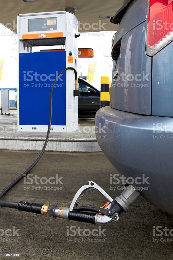 Refueling a car at LPG gas station stock photo