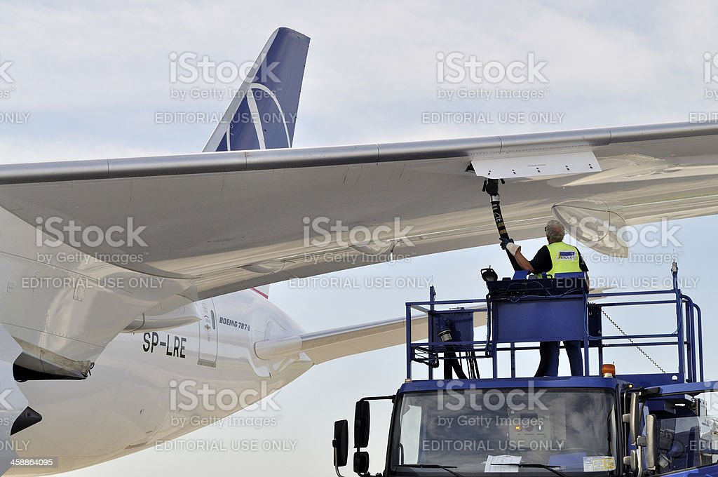 Refueling a plane stock photo