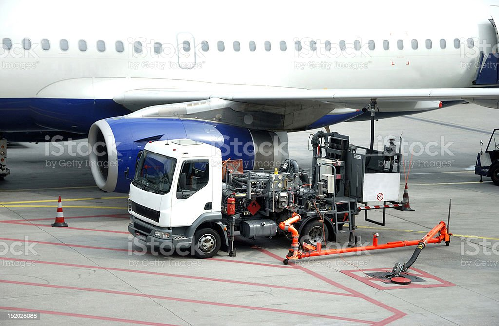 Refueling an airplane royalty-free stock photo