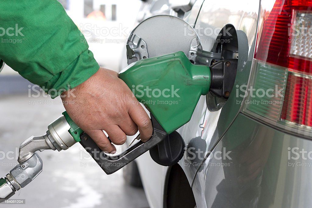 Refueling Automobile With Gasoline Pump Nozzle stock photo