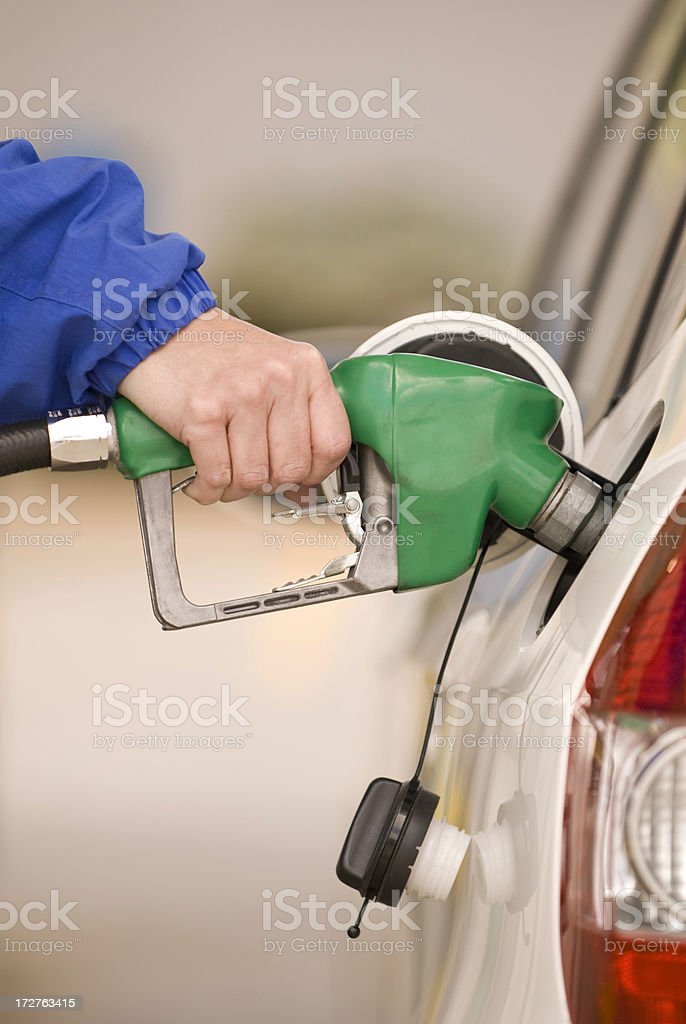 Refueling Automobile With Nozzle of Gasoline Pump royalty-free stock photo