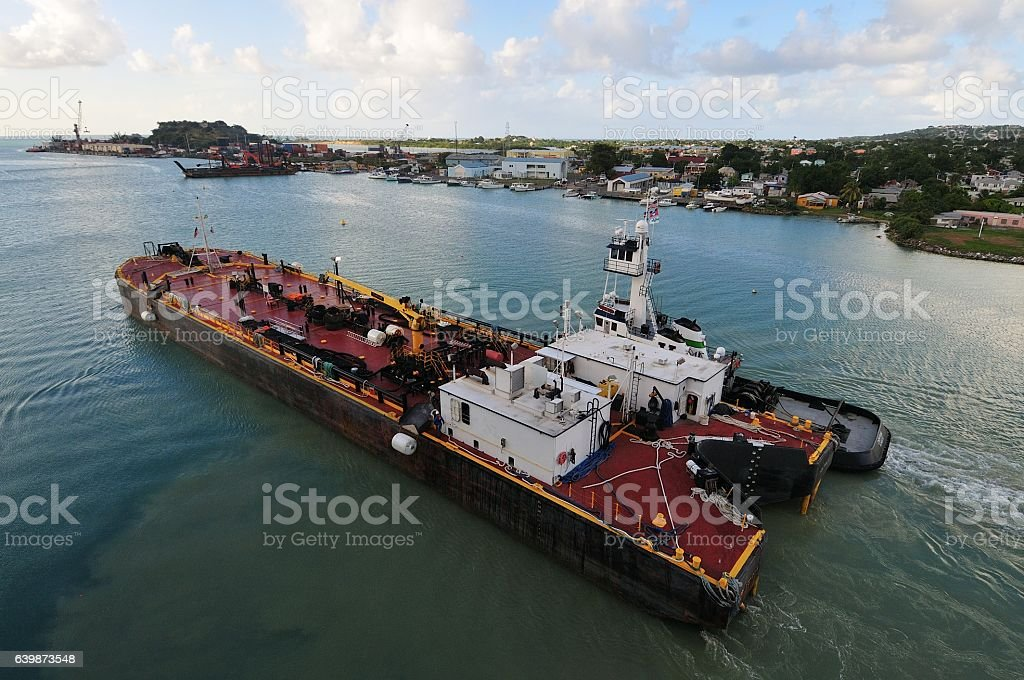 Refueling Barge Being Towed stock photo