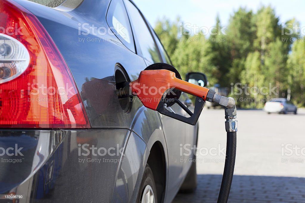 Refueling nozzle in the tank car at a gas station royalty-free stock photo