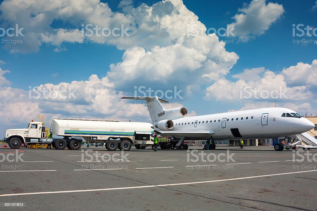 Refueling plane at a small airport royalty-free stock photo