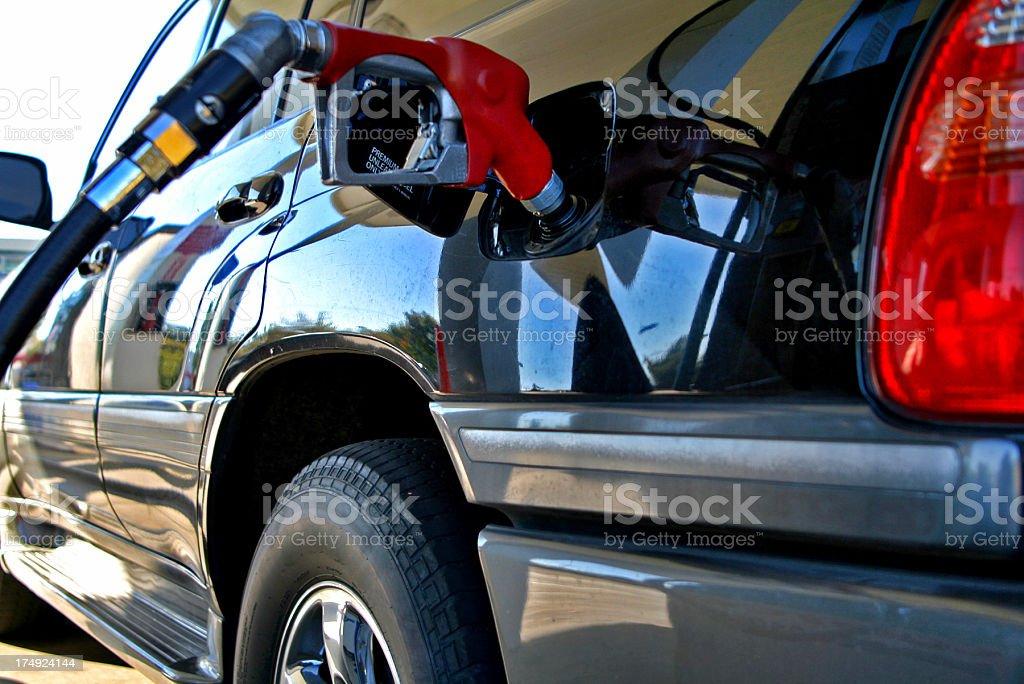 Refueling SUV royalty-free stock photo